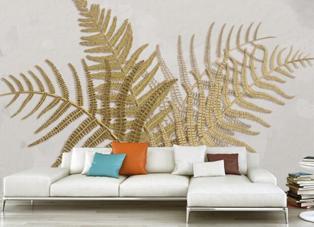 Золотые листья папоротника на белой стене