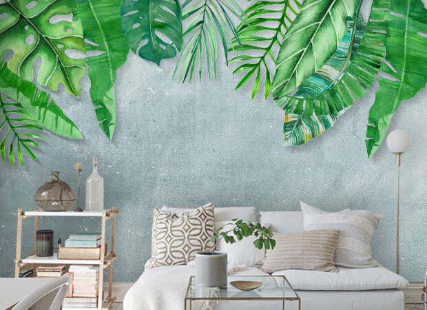 Листья пальм на серой стене