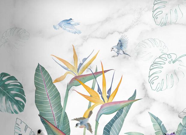 Птицы над распустившемся цветком