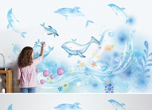 Дельфины и киты на волнах