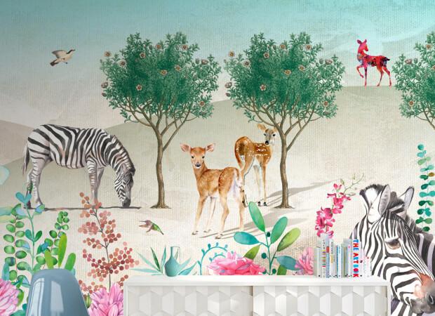 Олени и зебры возле дерева