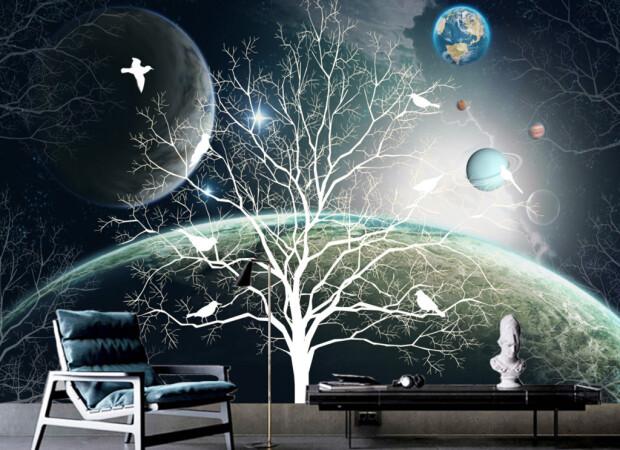 Белое дерево с птицами на фоне планет
